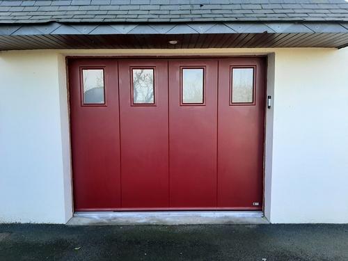 Porte de garage alu -sectionnelle motorisée - refoulement latéral - Lamballe