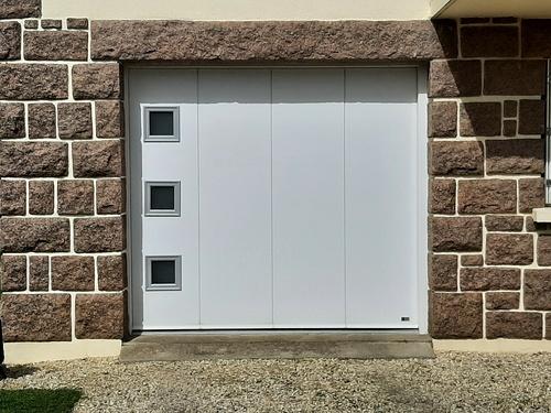 Remplacement porte de garage bois coulissante par une porte motorisée - Erquy