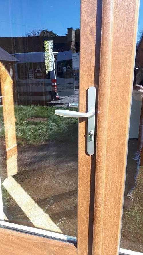 Menuiseries PVC aspect bois pour longère en pierre - Plaine Haute (22) resized201902211419424202