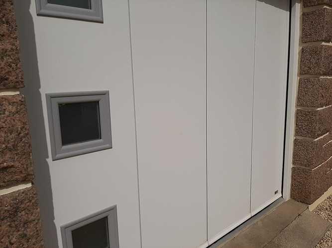 Remplacement porte de garage bois coulissante par une porte motorisée - Erquy 20210401144735